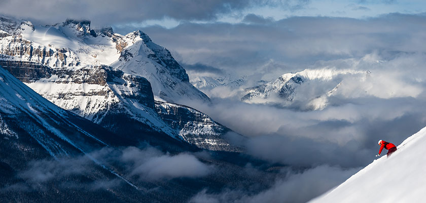 skier-in-lake-louise-with-mountains.jpg